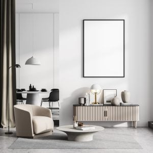 White room interior with armchair and coffee table, eating room on background, minimalist drawer with books and decoration, concrete floor. Blank canvas poster, 3D rendering