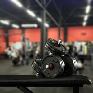 Dark interior of gym and dumbbells.Free space for your decoration and healthy life