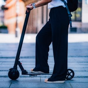 Close Up Image of Woman on Electric Scooter in the City.